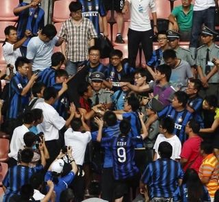 AC Milan fan lyhnched by Inter fans in China.jpg