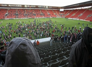 Slavia Praha supporters raid on VIP tribune.jpg